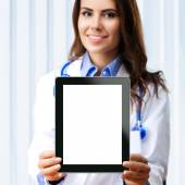 Female doctor showing blank tablet pc for copyspace — Stock Photo