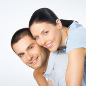 Portrait of cheerful smiling amorous young couple — Stock Photo
