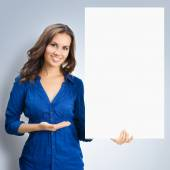 Happy smiling brunette woman showing blank signboard — Stock Photo
