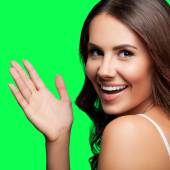 Happy gesturing young woman, on green chroma key background — Stock Photo