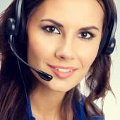 Portrait of smiling young female support phone operator  — Stockfoto