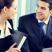 Happy businesspeople working at office — Stock Photo