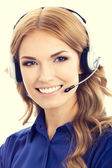 Portrait of female support phone operator or phone worker in hea — Stock Photo