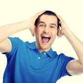 Portrait of shocked young man, looking at camera — Stock Photo