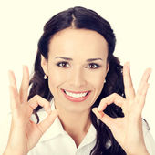 Businesswoman with okay gesture — Stock Photo