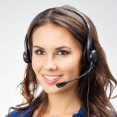 Smiling young female support phone operator, with copyspace, on — Stock fotografie