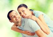 Young happy smiling amorous embracing lovely couple, outdoors — Stockfoto