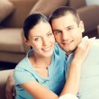 Young happy smiling lovely couple at home — Stock Photo #77306844