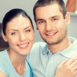 Young smiling lovely couple at home — Stock Photo #77306878