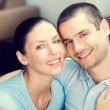 Happy smiling lovely couple at home — Stock Photo #77307042