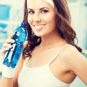 Woman drinking water, at fitness club — Stock Photo