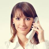Young businesswoman with phone — Stock Photo