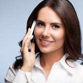 Cheerful customer support female phone operator with cell phone, — Stock Photo
