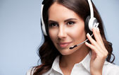 Portrait of customer support female phone worker, on grey — Stock Photo