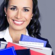 Happy businesswoman with office supplies — Stock Photo #79119838