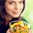 Young lovely woman with plate of salad — Stock Photo #79122668