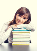 Young woman with textbooks — Stock Photo