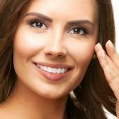 Closeup portrait of smiling beautiful young brunette woman touch — Stock Photo