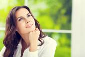 Thinking smiling attractive brunette businesswoman — Stock Photo