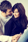 Isolated young attractive happy smiling amorous couple embracing — Stock Photo