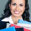 Young businesswoman with folders — Stock Photo #83091338