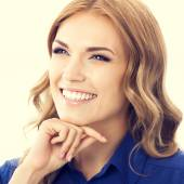 Young smiling thinking businesswoman — Stock Photo