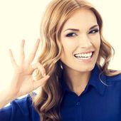 Businesswoman with okay gesture — Stock Photo