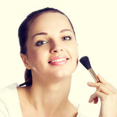 Woman with cosmetics brush — Stock Photo