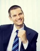 Happy gesturing businessman — Stock Photo