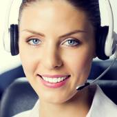 Female support phone operator at workplace — Stock Photo