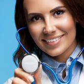 Doctor with stethoscope in hand, on blue — Stock Photo