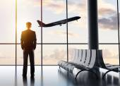 Businessman standing in airport — Stock Photo