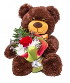 Bear with floral bouquet — Stock Photo