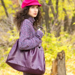 Young stylish woman with a big bag in the autumn park — Stock Photo #54983723