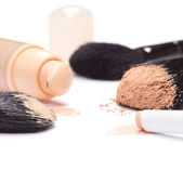 Foundation, concealer pencil and powder with makeup brushes — Foto de Stock