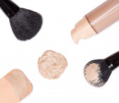Foundation with makeup brushes and cosmetic sponge — Stockfoto