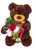 Teddy bear with a bouquet of flowers — Stock Photo