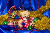 Charming small teddy bear with Christmas gift — Stock Photo