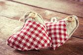 Rag hearts on wooden planks — Stock Photo