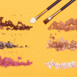 Different colors of crumbled compact eyeshadow — Stock Photo #75284535