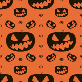 Seamless Halloween pattern of wickedly grinning pumpkins — Stock Photo