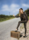 Beautiful female hitch hiker. — Stock Photo