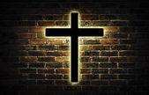 Wooden crucifix hanging on a brick wall. — ストック写真