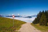 Mountain road in autumn landscape in Tirol Alps — Stock Photo