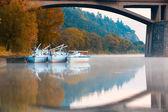 Three yachts in the harbor under a bridge in Prague — Stock Photo