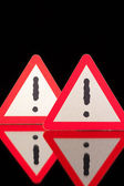 Danger warning signs on the black glass table — Stock Photo