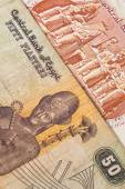 Different Egyptian  banknotes on the table — Stock Photo
