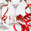 Three empty glasses on champagne and red ribbon — Stock Photo #61542659