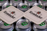 Pattern from much of drinking cans of beer and Krombacher beerma — Stock Photo