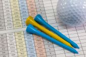 Golf equipments lying  on a golf score card — Stock Photo